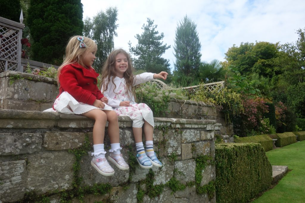 Sisters sitting together at Plas Newydd National Trust
