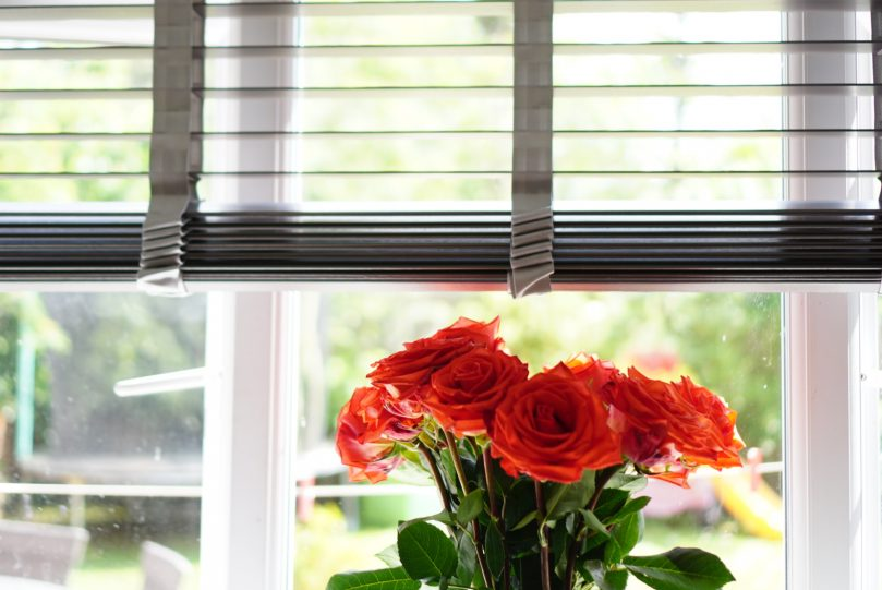 Blinds in a room with flowers