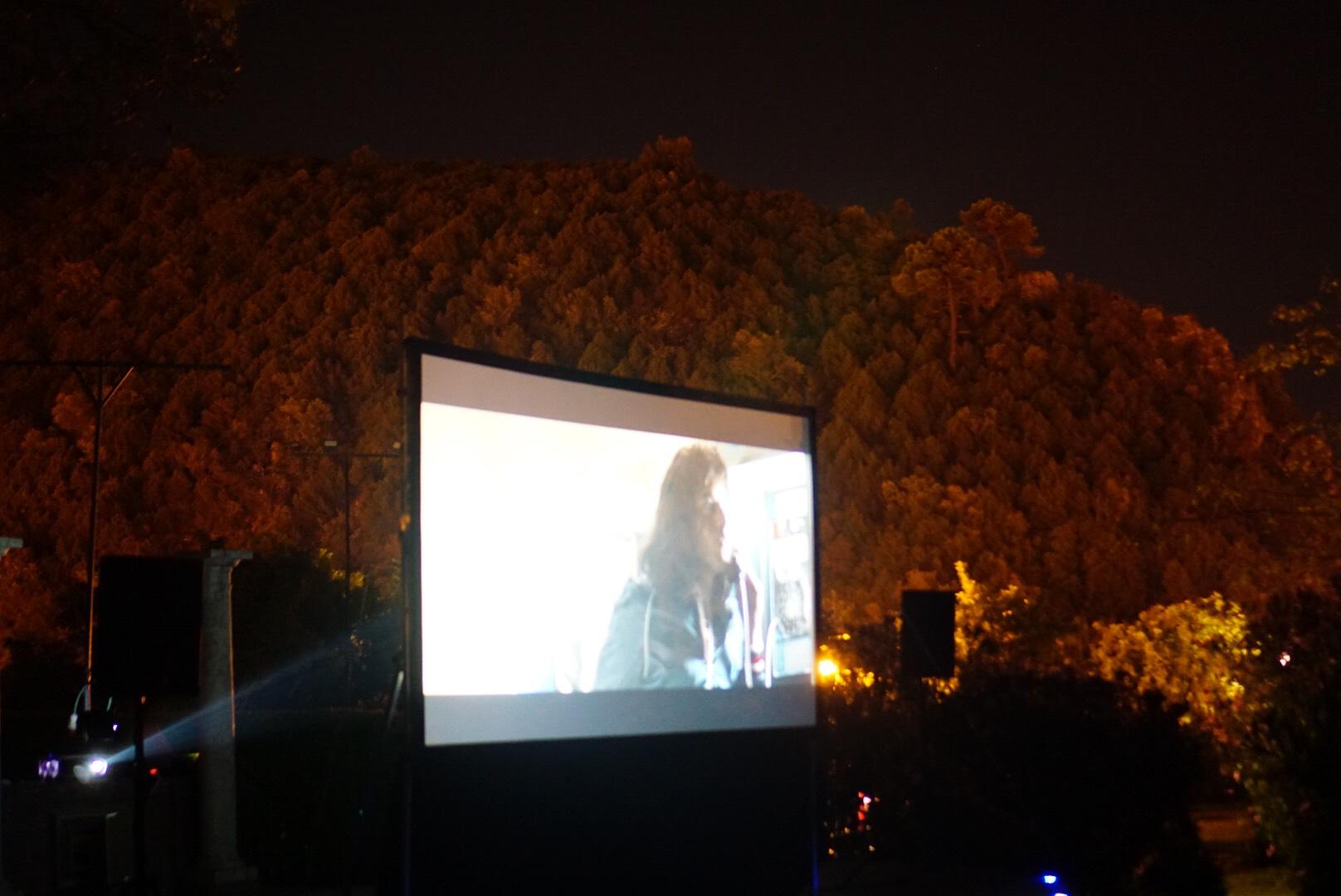 Bohemian Rhapsody on a large screen in a park in Benahavis