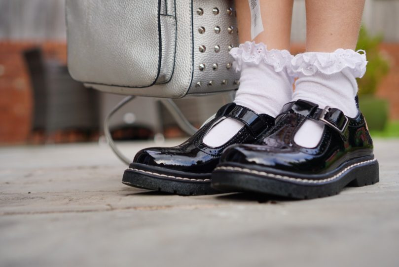 Lelli Kelly patent leather school shoes on a child